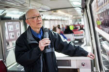 Jayme Gustilo, a 27-year veteran of Seattle's monorail, gives a speedy, two-minute tour of Seattle's downtown from the monorail on Wednesday, March 23, 2017.