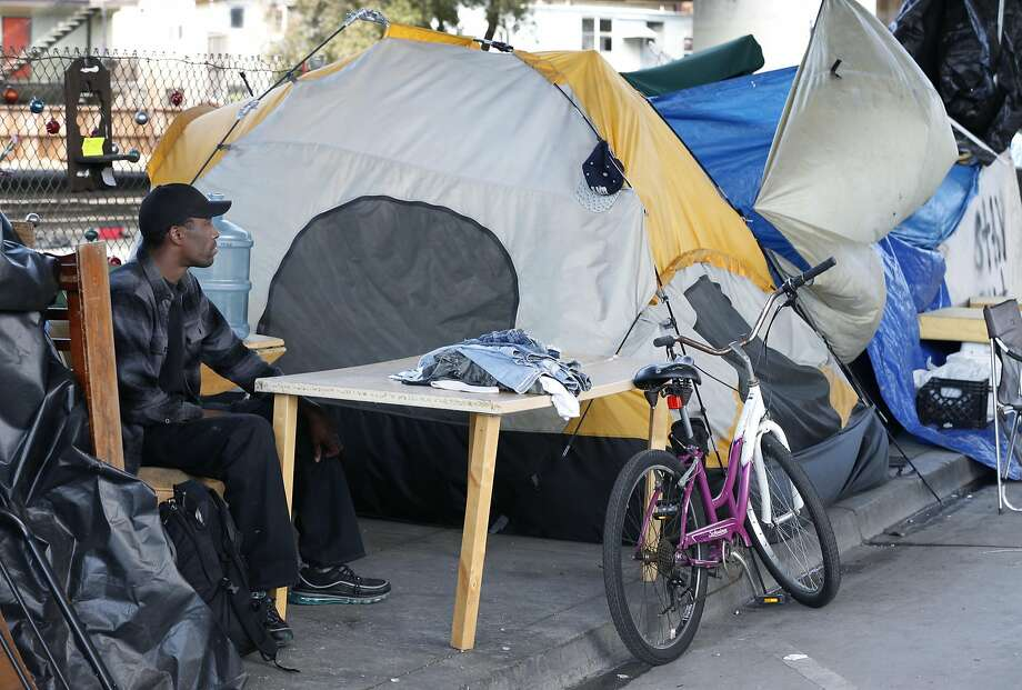 Shawn Moses sits in his space at a homeless camp on Northgate Avenue in Oakland. He says he has lived there for three years. Photo: Paul Chinn, The Chronicle