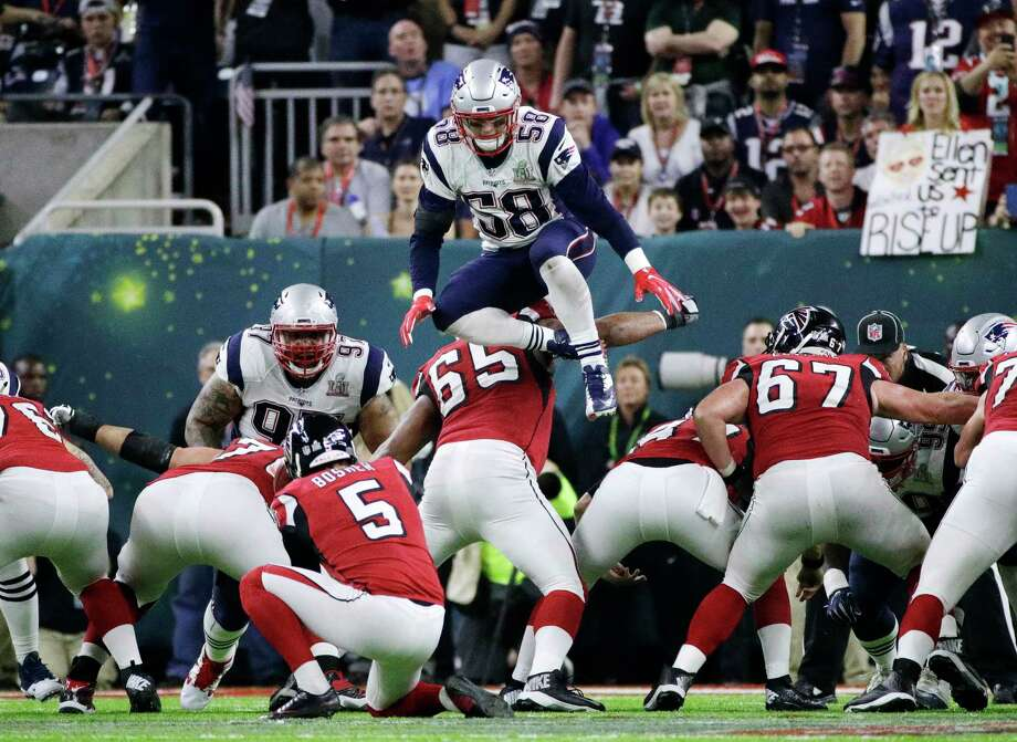 In this Feb. 5, 2017, file photo, New England Patriots' Shea McClellin (58) leaps over the line of scrimmage in an attempt to block a kick during the first half of the NFL Super Bowl 51 football game in Houston. NFL owners will consider proposals next week to cut regular-season overtime from 15 minutes to 10; eliminate players leaping over the line on kick plays; and expansion of coaches' challenges and what can be reviewed by officials. Photo: Jae C. Hong, STF / Copyright 2017 The Associated Press. All rights reserved.