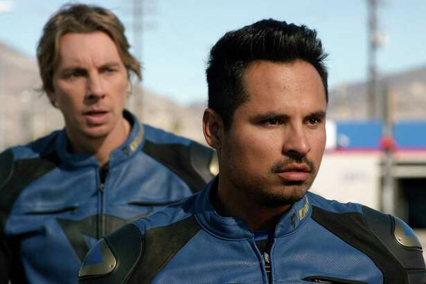 """This image released by Warner Bros. Pictures shows Michael Pena, foreground, and Dax Shepard in a scene from, """"CHiPS."""" (Warner Bros via AP) ORG XMIT: NYET814"""