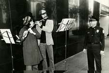 Hannah Morton and David Smith perform for security guard Lawrence Jacobs in front of Wells Fargo on Jan. 8, 1972 in San Francisco.