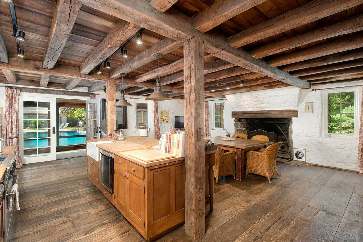 Westport: The house's roots as a barn are obvious from its wooden beamed ceilings, particularly in the living room.