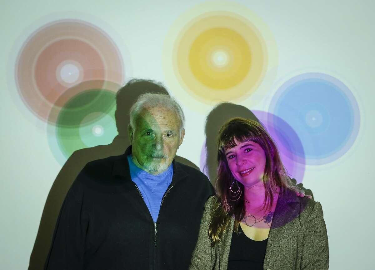 Paul Ekman and his daughter, Eve, the world's foremost authorities on emotions and empathy, stand for a portrait in front of a projection of the Atlas of Emotion.