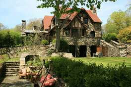 The stone manor, at 24 Old Wagon Road in Ridgefield, Conn. was built in 1911 and designed by Grosvenor Atterbury, a well-known architect who designed for a lot of prominent people. The house also stands out for its gardens, which were designed by Warren H. Manning, and are being documented for the Smithsonian.