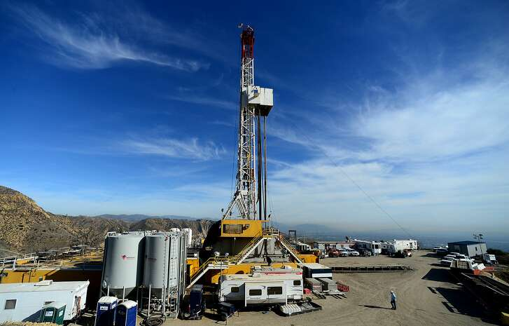 FILE - In this Dec. 9, 2015 file photo, crews work on a relief well at the Aliso Canyon facility above the Porter Ranch area of Los Angeles. The escape of tons of natural gas from under a Los Angeles neighborhood is taking months to stop because of pressure from the leak. The leak at Porter Ranch started in October, and likely won�t be fixed for at least two more months. Officials have relocated several thousand residents who said the stench made them sick. (Dean Musgrove/Los Angeles Daily News via AP, Pool, File)