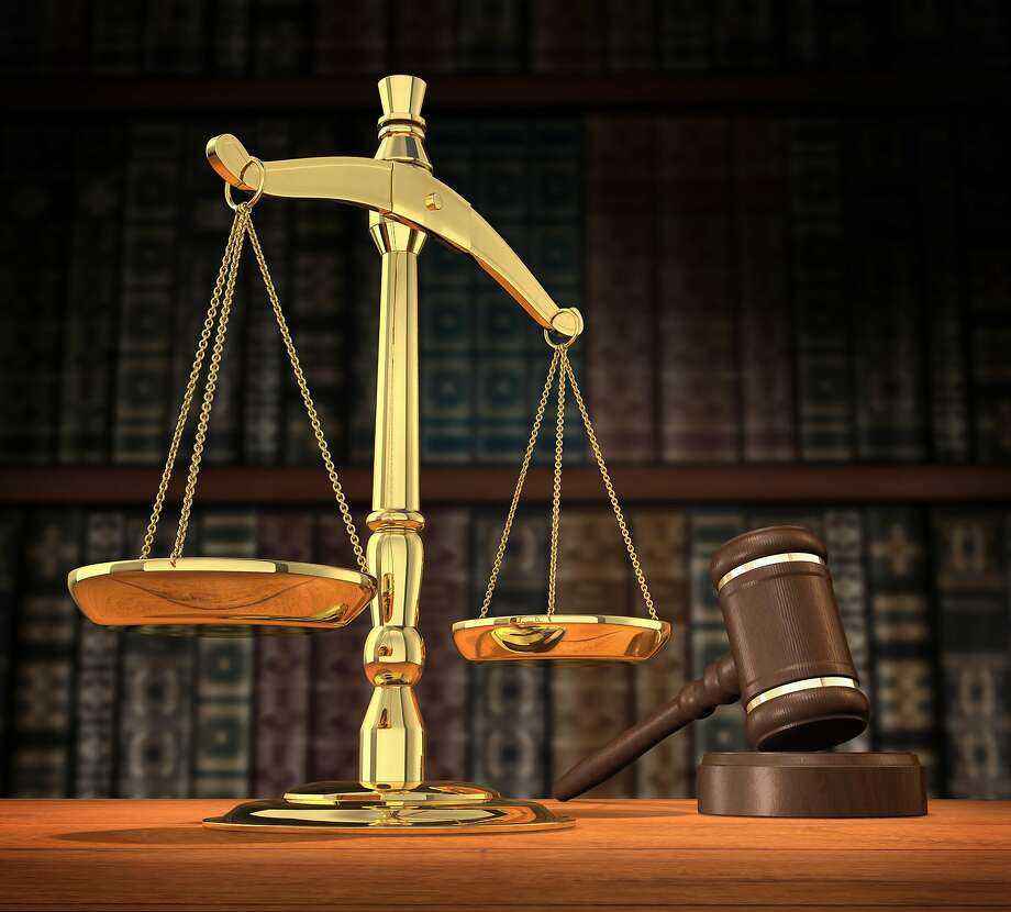 Scales of justice and gavel on desk with dark background that allows for copyspace. Photo: James Steidl, ST