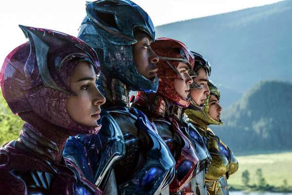"""In this image released by Lionsgate, Naomi Scott, from left,  RJ Cyler, Dacre Montgomery, Ludi Lin and Becky G appear in a scene from, """"Power Rangers."""" (Kimberly French/Lionsgate via AP)"""
