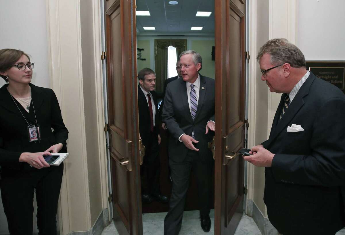 House Freedom Caucus Chairman Rep. Mark Meadows, R-N.C. departs a Freedom Caucus meeting on Capitol Hill in Washington, Thursday, March 23, 2017. GOP House leaders delayed their planned vote on a long-promised bill to repeal and replace