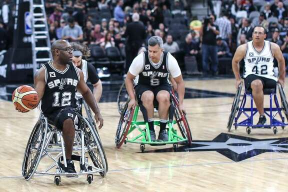 Charles Armstead (12) competes for the Spurs-sponsored wheelchair basketball team during a 2017 game at the AT&T Center.