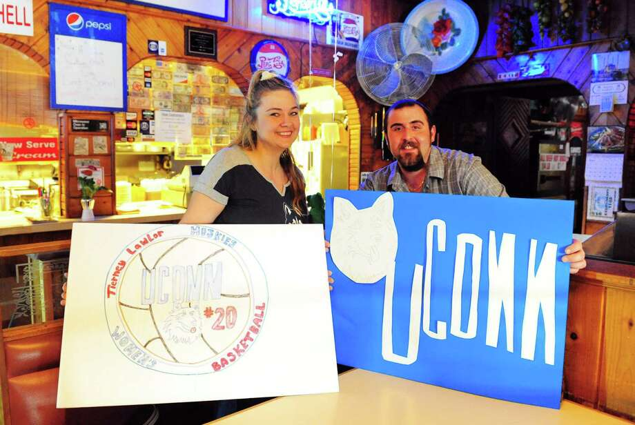 J.R.B.'s Family Restaurant employee Monica Coddington and manager John Kahyaoglu pose with posters Coddington made to hang at the establishment in downtown Ansonia, Conn., on Tuesday Mar. 21, 2017. Ansonia folks and businesses are inspired by UConn women's basketball player Tierney Lawlor, who grew up in Ansonia. Photo: Christian Abraham / Hearst Connecticut Media / Connecticut Post