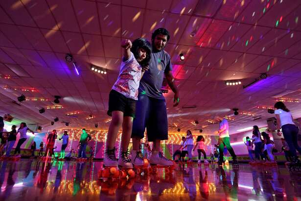 David Chavez helps his daughter Annabell Chavez, 6, skate at The Rollercade, where even grandparents sometimes share a skate with their kids and grandchildren.