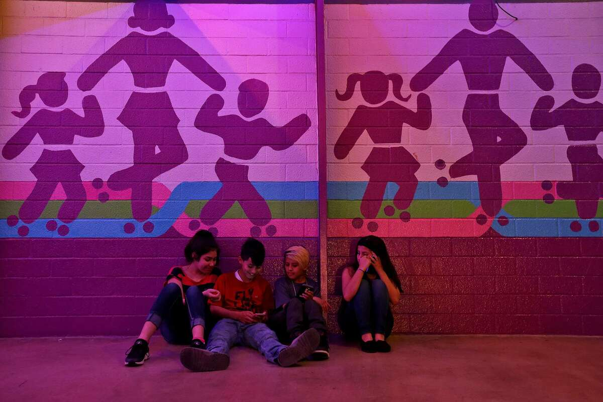 Jessica Ramirez, 11, (from left), Jacob Rocha, 12, Rico James, 12, and Janelle Rocha,13, wait outside The Rollercade to be picked up. The rink has hosted generations of kids and kids at heart across several decades.