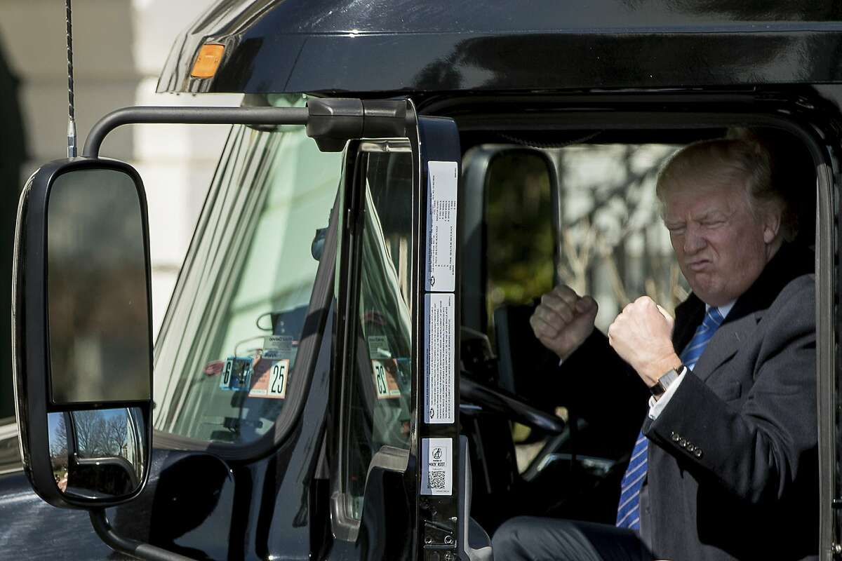 President Trump gestures while sitting in an 18-wheeler while meeting with truckers and CEOs about health care at the White House on Thursday.