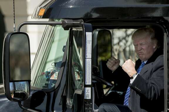 President Donald Trump gestures while sitting in an 18-wheeler truck while meeting with truckers and CEOs regarding healthcare on the South Lawn of the White House in Washington, Thursday, March 23, 2017. (AP Photo/Andrew Harnik)