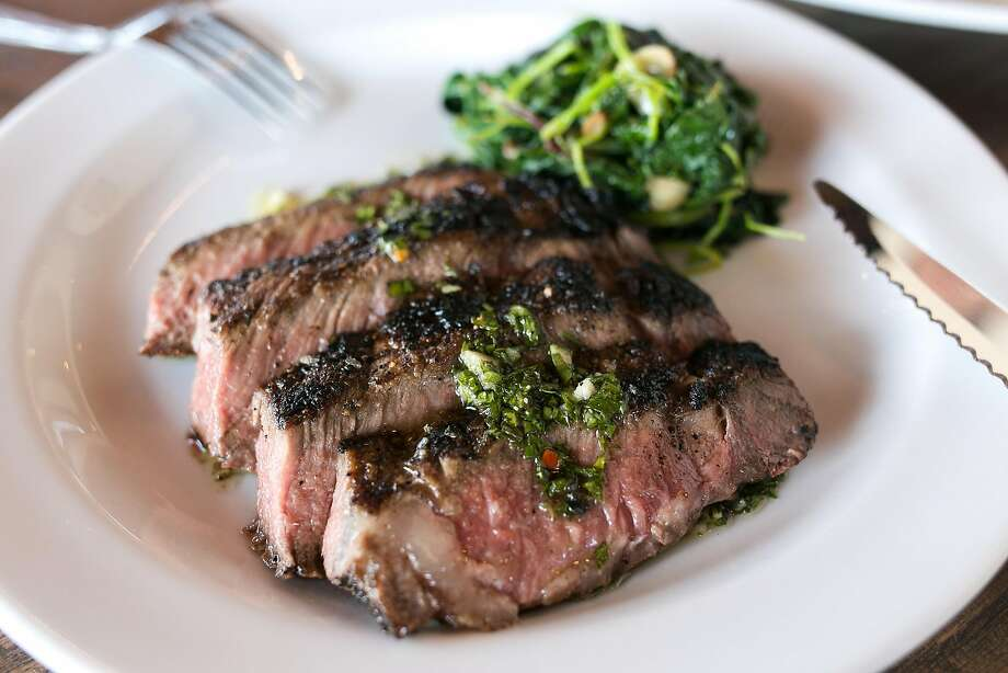 Niman Ranch's rib eye is used in this dish with garlic greens and chimichurri at Atwater Tavern in San Francisco. Photo: Jen Fedrizzi, Special To The Chronicle