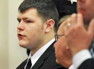 Matthew Slocum, left, is sentenced at the Washington County Court in Fort Edward N.Y., Friday March 30, 2012. Slocum was sentenced to 101 years to life in prison for killing his mother, stepfather and stepbrother inside their White Creek home last summer and setting the house on fire. (John Carl D'Annibale / Times Union)