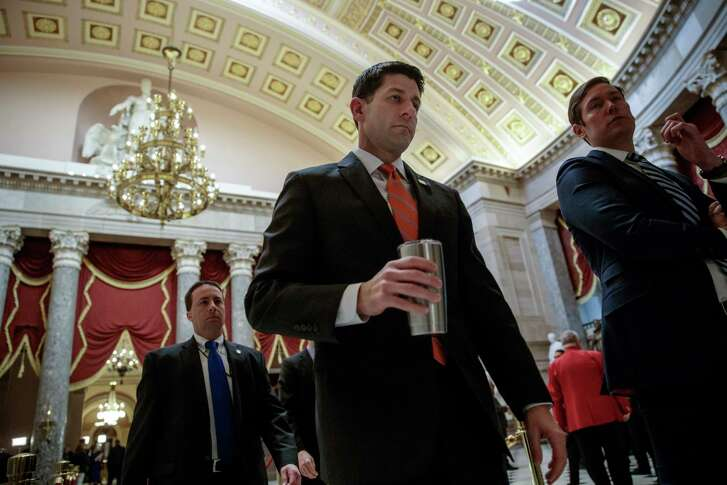 House Speaker Paul Ryan of Wisconsin walks to his office on Capitol Hill in Washington Thursday, as he and the Republican leadership scramble for votes on their health care overhaul in the face of opposition from reluctant conservatives in the House Freedom Caucus. (AP Photo/J. Scott Applewhite)