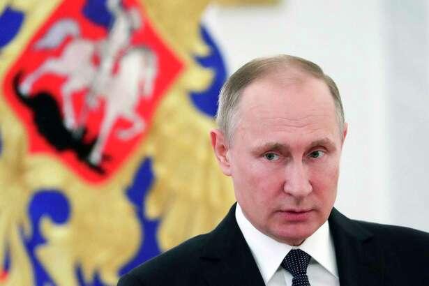 Russian President Vladimir Putin speaks during a meeting with senior military officers in the Kremlin in Moscow, Russia, Thursday, March 23, 2017. (Alexei Druzhinin/Sputnik, Kremlin Pool Photo via AP)