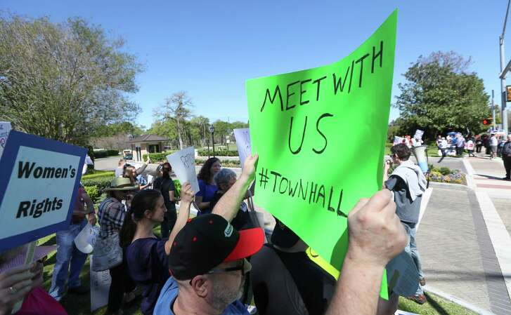 Protesters upset that they were not allowed in a February meeting with U.S. Rep. John Culberson, R-Houston, gathered outside the Lakeside Country Club in Houston. ( Steve Gonzales  / Houston Chronicle )