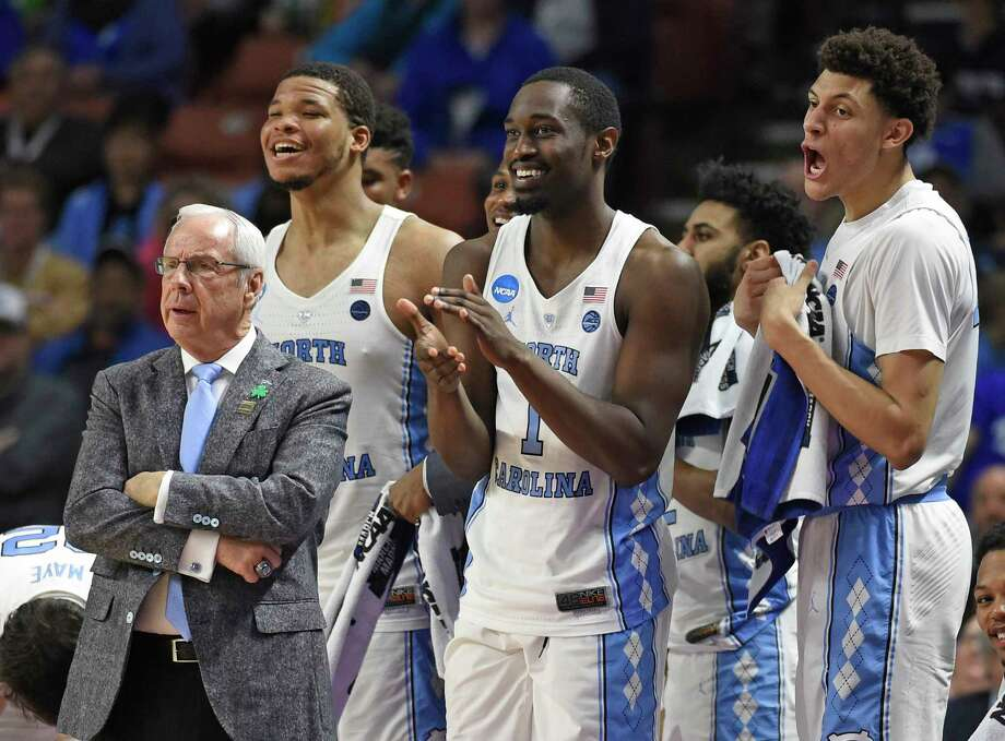 In this March 17, 2017, file photo, North Carolina head coach Roy Williams, left, and players Kennedy Meeks, Theo Pinson and Justin Jackson react during the second half against Texas Southern in a first-round game of the NCAA men's college basketball tournament in Greenville, S.C. Williams has long emphasized the importance of rebounding and his Tar Heels lead the country in rebounding margin entering the Friday, March 24, game against Butler in the NCAA Tournament's South Region semifinals. Photo: Rainier Ehrhardt, Associated Press / FR155191 AP