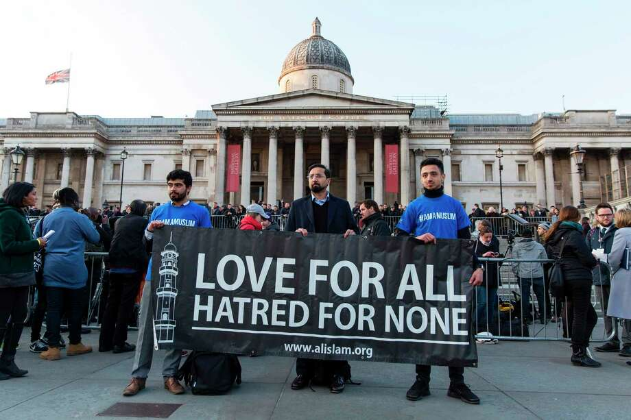 Members of the Muslim group 'Al Islam' stand in solidarity with the victims of Wednesday's terror attack at the British Parliament and Westminster Bridge in which five people were killed, including the assailant. Photo: JOEL FORD, Stringer / AFP or licensors