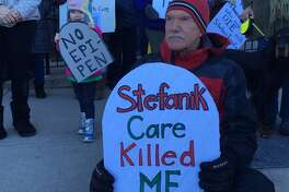 A protester want to send a message to Congresswoman Stefanik. (Wendy Liberatore/Times Union)