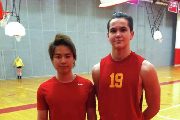Teppei Yoshikawa, left, and Alessandro Perrier will serve as senior captains on the Greenwich High School boys volleyball team.