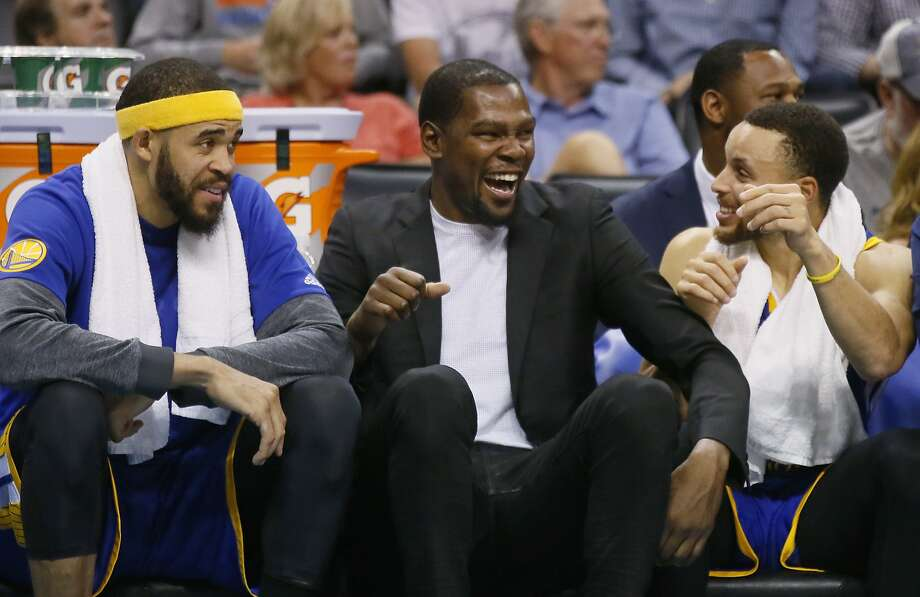 Golden State Warriors center JaVale McGee, left, injured forward Kevin Durant, center, and guard Stephen Curry, right, laugh on the bench in the fourth quarter of an NBA basketball game against the Oklahoma City Thunder in Oklahoma City, Monday, March 20, 2017. Golden State won 111-95. (AP Photo/Sue Ogrocki) Photo: Sue Ogrocki, Associated Press