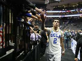 UCLA Bruins guard Lonzo Ball slaps hands as he walks to the locker room after UCLA beat Cincinnati 79-67 in a second-round game of the men's NCAA college basketball tournament in Sacramento, Calif., Sunday, March 19, 2017. (AP Photo/Rich Pedroncelli)