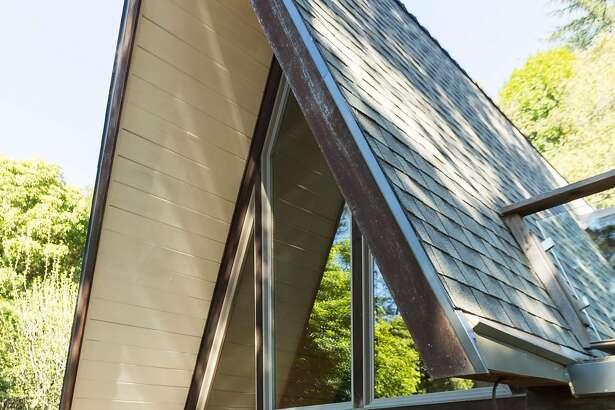 The rear facade highlights the home's A-frame construction.�
