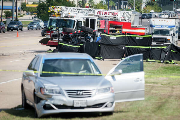 Emergency personnel work the scene of a three-vehicle crash that resulted in four deaths on Sunday, Sept. 20, 2016 on Texas 105 and Marina Drive. Three other people involved in the crash were hospitalized with non-life threatening injuries.