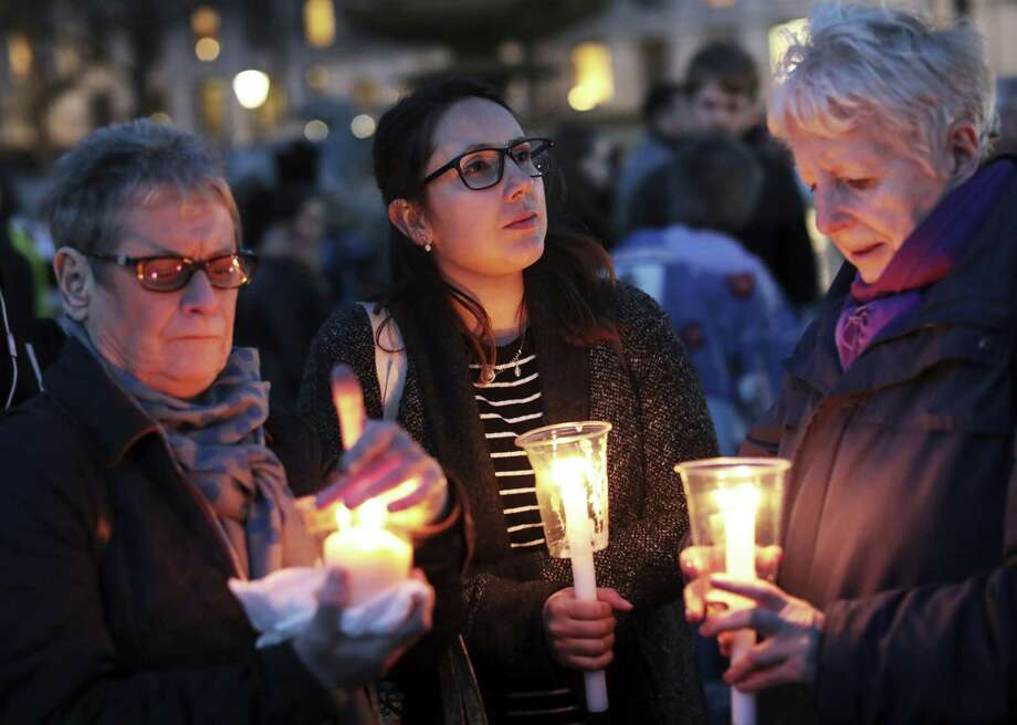 "LONDON, ENGLAND - MARCH 23:  Members of the public light candles during a candlelit vigil at Trafalgar Square on March 23, 2017 in London, England. Four People were killed in Westminster, London,  yesterday in a terrorist attack by ""lone wolf"" killer Khalid Masood,52.  Three of the victims have been named as PC Keith Palmer, US tourist Kurt Cochran from Utah and Mother of two Aysha Frade.  (Photo by Jack Taylor/Getty Images) ORG XMIT: 700024120 Photo: Jack Taylor / 2017 Getty Images"