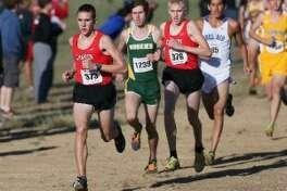 Alex Rogers (far left) leads a pack of runners, including Sam Worley (third from left) during the Region IV cross country championships in 2014. The former teammates at New Braunfels Canyon are scheduled to race against each other at next week's Texas Relays in Austin. (Staff photo).