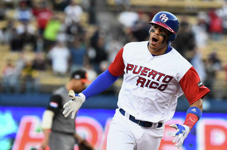 Puerto Rico's Carlos Correa rounds the bases after his two-run homer Monday against the Netherlands. Photo: Jayne Kamin-Oncea, Stringer / 2017 Getty Images