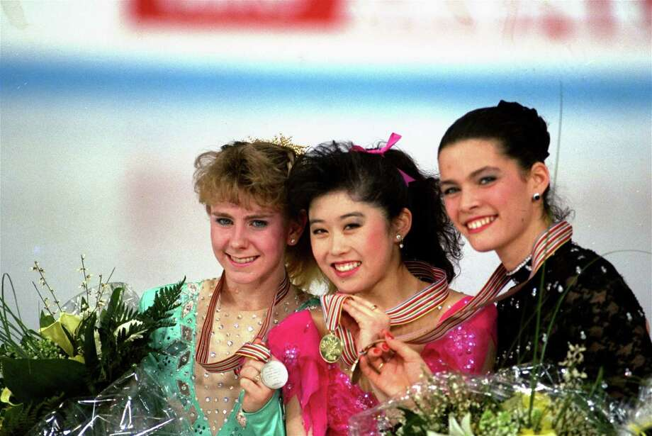 "FILE - In this March 12, 1991, file photo, American skaters (L to R) Tonya Harding, silver; Kristi Yamaguchi, gold; and Nancy Kerrigan, bronze, display their medals after the finals of the World Figure Skating Championships in Munich. A run-of-the-mill good luck tweet from Yamaguchi to Kerrigan is drawing online attention. Yamaguchi tweeted a message to Kerrigan ahead of Kerrigan's performance on Monday's ""Dancing with the Stars"" March 20, 2017, and added ""break a leg."" Kerrigan was hit in the leg before the 1994 Winter Olympics by a man hired by the ex-husband of Harding. Yamaguchi's spokeswoman says ""no ill will was intended."" (AP Photo/Diether Endlicher, File) ORG XMIT: PAPM104 Photo: Diether Endlicher / AP1991"