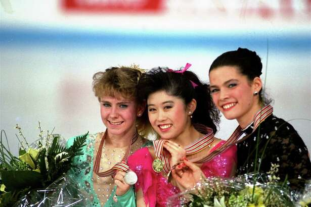 "FILE - In this March 12, 1991, file photo, American skaters (L to R) Tonya Harding, silver; Kristi Yamaguchi, gold; and Nancy Kerrigan, bronze, display their medals after the finals of the World Figure Skating Championships in Munich. A run-of-the-mill good luck tweet from Yamaguchi to Kerrigan is drawing online attention. Yamaguchi tweeted a message to Kerrigan ahead of Kerrigan's performance on Monday's ""Dancing with the Stars"" March 20, 2017, and added ""break a leg."" Kerrigan was hit in the leg before the 1994 Winter Olympics by a man hired by the ex-husband of Harding. Yamaguchi's spokeswoman says ""no ill will was intended."" (AP Photo/Diether Endlicher, File) ORG XMIT: PAPM104"