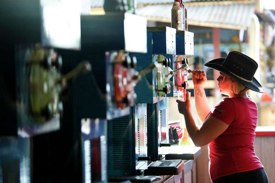 Bartender Rebecca Brannan pours a frozen margarita. Alcohol sales ultimately helps support the Houston Livestock Show and Rodeo's agricultural mission, said President and CEO Joel Cowley. Photo: Michael Ciaglo, Staff / Michael Ciaglo