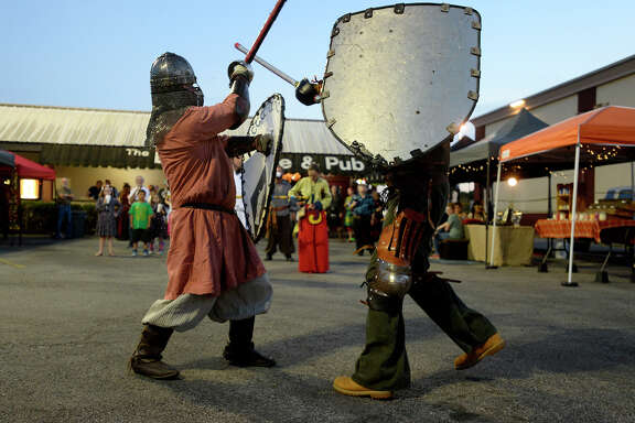 Beau Dumesnil, left, and Conrad Kuehn fight during the Mini RenFest at The Logon Cafe on Thursday evening. Costumed revelers came to see performances by The Ukulady's Man and Belarusian band Stary Olsa.  Photo taken Thursday 3/23/17 Ryan Pelham/The Enterprise