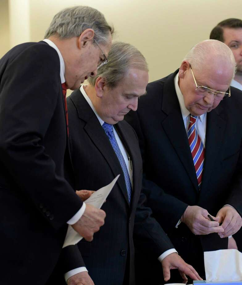 Former Senator George Maziarz, second from left, with his attorneys E. Stewart Jones of Troy, left, and Joe Latona of Buffalo, center, stands before Judge Peter Lynch for his arraignment in Albany County Court on five counts of offering a false instrument for filing in the first degree on Thursday, March 23, 2017, in Albany, N.Y. (Skip Dickstein/Times Union) Photo: SKIP DICKSTEIN / 20040044A