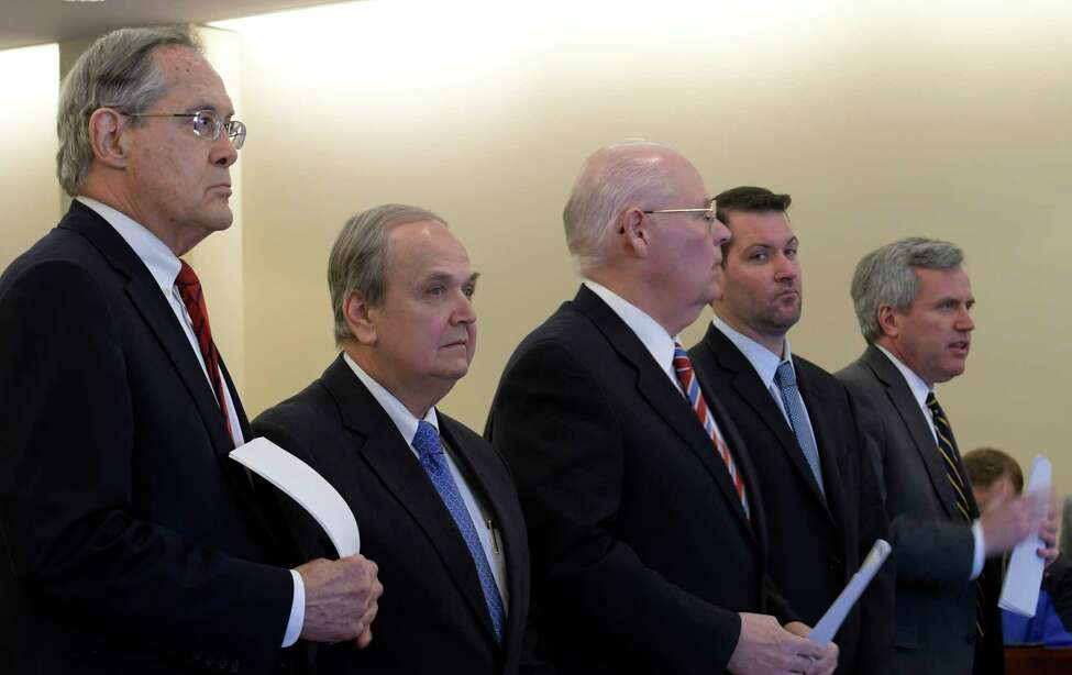 Former Senator George Maziarz, second from left, with his attorneys E. Stewart Jones of Troy, left, and Joe Latona of Buffalo, center, stands before Judge Peter Lynch for his arraignment in Albany County Court on five counts of offering a false instrument for filing in the first degree on Thursday, March 23, 2017, in Albany, N.Y. (Skip Dickstein/Times Union)