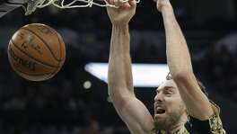 Pau Gasol jams a shot home as the Spurs host the Grizzlies at the AT&T Center on March 23, 2017.
