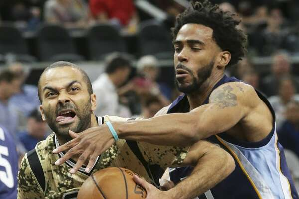 Tony Parker fights  Mike Conley to get to the lane as the Spurs host the Grizzlies at the AT&T Center on March 23, 2017.