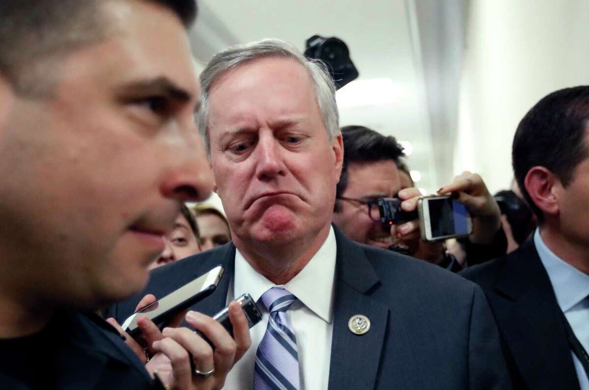 House Freedom Caucus Chairman Rep. Mark Meadows, R-N.C. reacts to a reporters question on Capitol Hill in Washington, Thursday, March 23, 2017, following a Freedom Caucus meeting. GOP House leaders delayed their planned vote on a long-promised bill to repeal and replace
