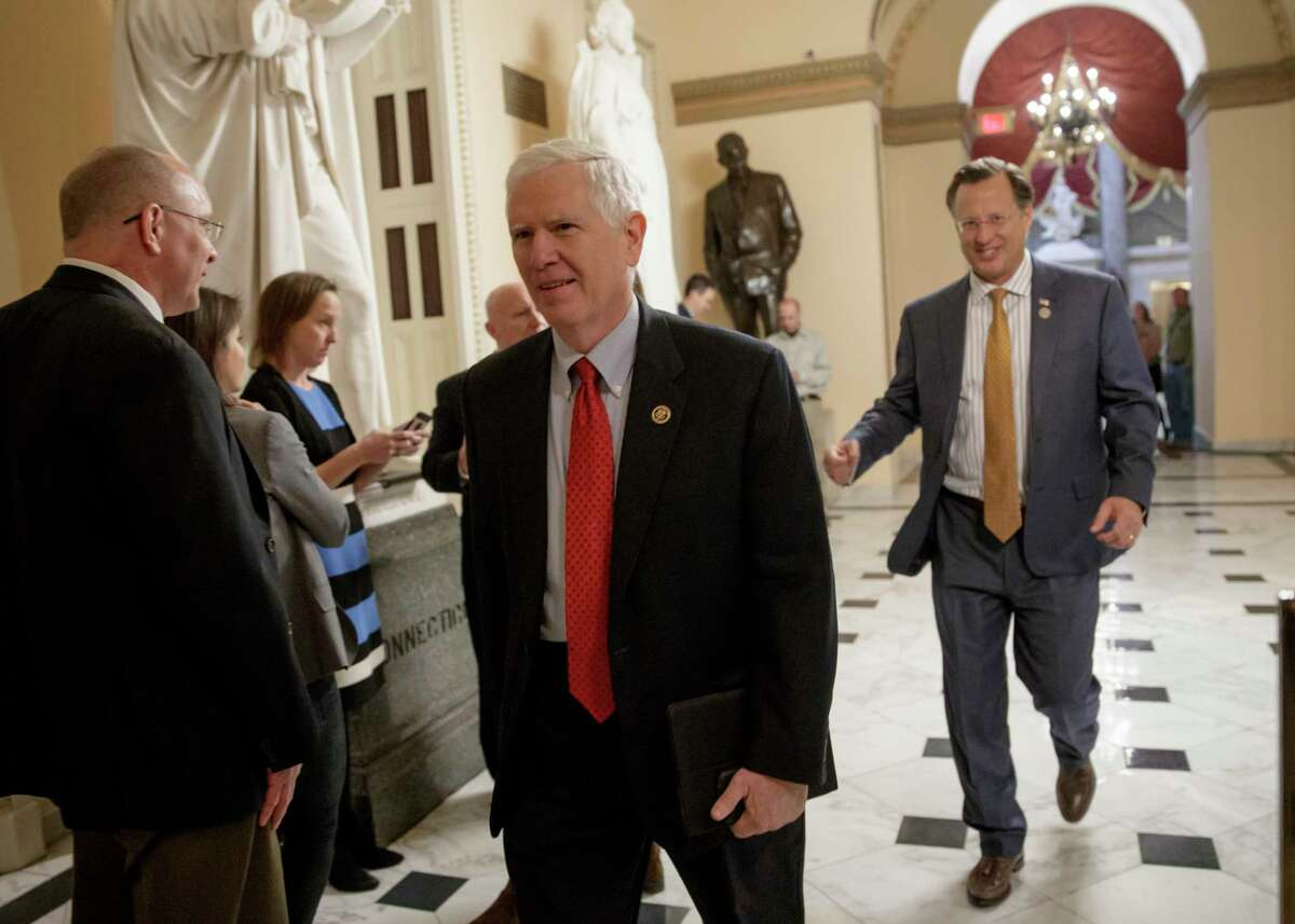 Rep. Mo Brooks, R-Ala., left, and Rep. Dave Brat, R-Va., members of the conservative Freedom Caucus, leave Capitol Hill in Washington, Thursday, March 23, 2017, to meet with President Donald Trump as the GOP's long-promised legislation to repeal and replace