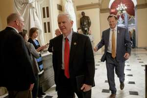 "Rep. Mo Brooks, R-Ala., left, and Rep. Dave Brat, R-Va., members of the conservative Freedom Caucus, leave Capitol Hill in Washington, Thursday, March 23, 2017, to meet with President Donald Trump as the GOP's long-promised legislation to repeal and replace ""Obamacare"" moves to a showdown vote. (AP Photo/J. Scott Applewhite) ORG XMIT: DCSA124"