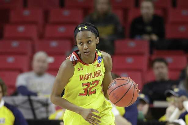 Maryland guard Shatori Walker-Kimbrough drives against West Virginia on Sunday in College Park, Md.