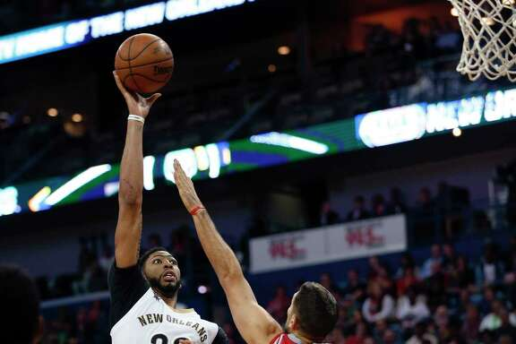 Forward Anthony Davis, left, didn't have new addition DeMarcus Cousins when the Pelicans defeated Ryan Anderson and the Rockets a week ago.