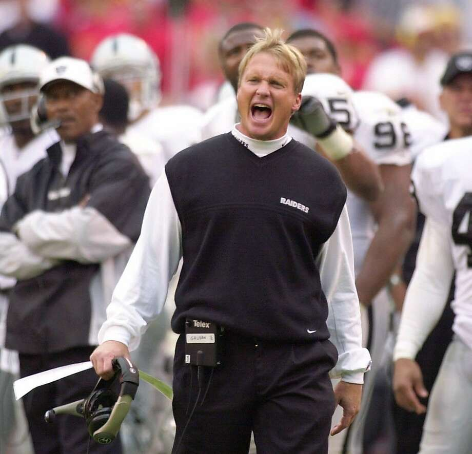 FILE--Oakland Raiders coach Jon Gruden yells to his team while officials review a play in the second half against the Kansas City Chiefs in Kansas City, Mo., in this Oct, 15, 2000 photo. Gruden, thought to be out of the running, was hired Monday, Feb. 18, 2002, as coach of the Tampa Bay Buccaneers.  Photo: JIM BARCUS, AP