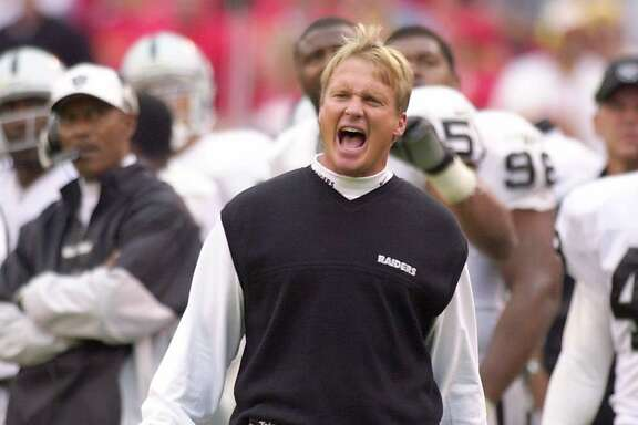 FILE--Oakland Raiders coach Jon Gruden yells to his team while officials review a play in the second half against the Kansas City Chiefs in Kansas City, Mo., in this Oct, 15, 2000 photo. Gruden, thought to be out of the running, was hired Monday, Feb. 18, 2002, as coach of the Tampa Bay Buccaneers. (AP Photo/Jim Barcus)