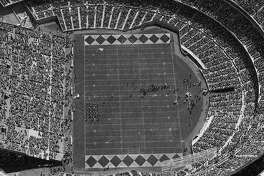 Aerial views of Opening Day for the Oakland Raiders at their new stadium, The Oakland Coliseum, 09/18/1966